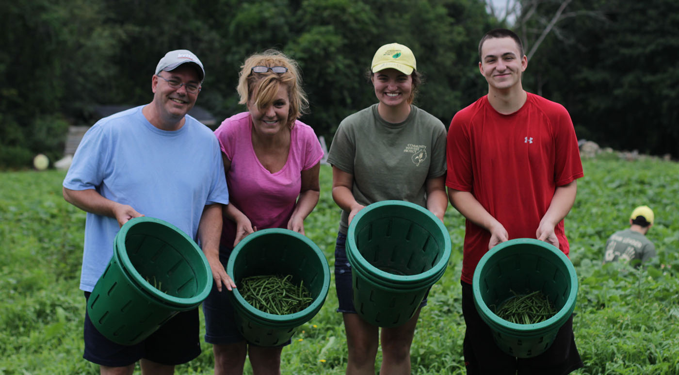 Volunteers with baskets of green beans – sized for slider